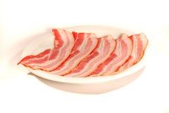 Bacon em uma placa Imagem de Stock Royalty Free