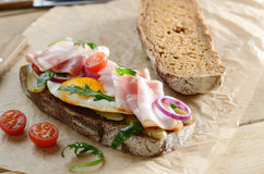 Bacon and fried egg open sandwich Stock Image