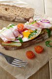 Bacon and fried egg open sandwich Royalty Free Stock Images