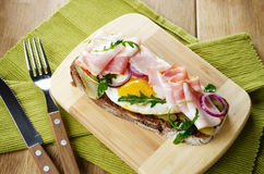 Bacon and fried eggs open sandwich Royalty Free Stock Photo