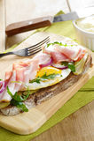 Bacon and fried eggs open sandwich Royalty Free Stock Image