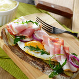 Bacon and fried eggs open sandwich Stock Image