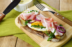Bacon and fried eggs open sandwich Royalty Free Stock Photography
