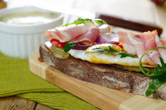 Bacon and fried eggs open sandwich Royalty Free Stock Images