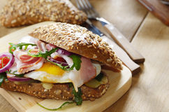 Bacon and fried eggs sandwich Stock Image