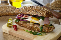 Bacon and fried eggs sandwich Stock Images