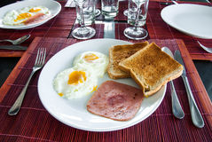 Bacon, fried eggs and toast Royalty Free Stock Photos