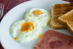 Bacon, fried eggs and toast Stock Photo