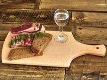 Bacon  and  glass of vodka. Lard, bread, a glass of vodka, onions Royalty Free Stock Images