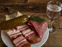 Bacon  and  glass of vodka. Lard, bread, a glass of vodka, onions Royalty Free Stock Photos
