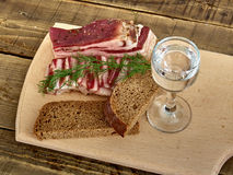 Bacon  and  glass of vodka. Lard, bread, a glass of vodka, onions Stock Image