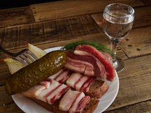Bacon  and  glass of vodka Royalty Free Stock Image