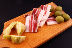 Bacon, green olives, artichoke Royalty Free Stock Photo