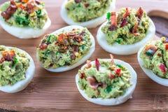 Bacon guacamole deviled eggs Stock Photography