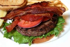 Bacon on hamburger Royalty Free Stock Photos