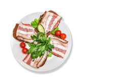 Bacon with herbs and tomatoes Stock Photo
