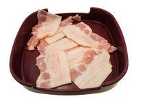 Bacon i det isolerade bruna magasinet Arkivbilder