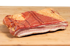 Bacon on a kitchen Board Stock Photos