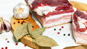 Bacon with layers of meat. And spices for cooking traditional food Royalty Free Stock Photos