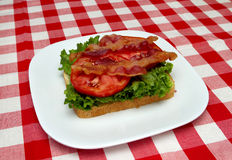 Bacon, lettuce and tomato on bread Stock Images