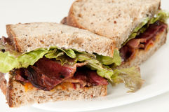 Bacon, lettuce and tomato sandwich. A classic BLT, bacon, lettuce and tomato sandiwch on organic seed bread Royalty Free Stock Photo