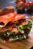 Bacon lettuce and tomato sandwich. BLT sandwich with fried bacon, lettuce and tomato in slices of bread Stock Photography