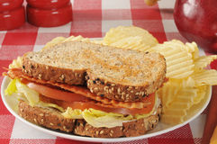 ... BLT sandwich on sprouted whole grain nut and seed bread with an apple