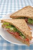 Bacon Lettuce and Tomato Sandwich. On malted whole grain bread Royalty Free Stock Image