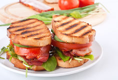 Bacon, lettuce and tomato sandwiches Royalty Free Stock Photo