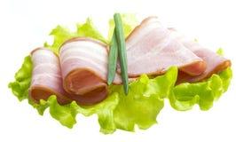 Bacon met saladebladeren Royalty-vrije Stock Foto's