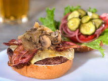 Bacon, mushroom and Swiss cheese burger, open face Royalty Free Stock Image