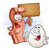 Bacon- och äggtecken som rymmer tecknet Royaltyfria Bilder