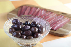 Bacon and olives. Olives and stips of bacon royalty free stock photo