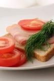 Bacon på en skiva av bröd Royaltyfria Bilder