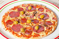 Bacon and pepperoni pizza Stock Photography