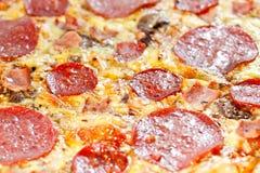 Bacon and pepperoni pizza Stock Photos
