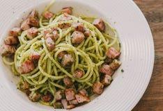 Bacon pesto pasta. Spaghetti with pesto sauce and bacon Stock Photos