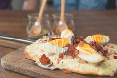 Closeup pizza. Bacon pizza ontop with boiled egg royalty free stock images