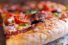 Bacon Pizza A Shallow Depth of Field Close up Food Photography. Bacon Pizza A Shallow Depth of Field Close up pepperoni, cheese, olive. Stock Food Photography Royalty Free Stock Photos