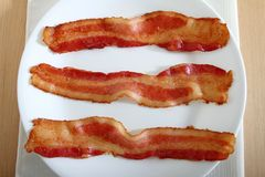 Bacon on a plate Stock Images