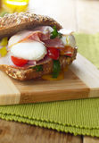 Bacon and poached eggs sandwich Royalty Free Stock Photo