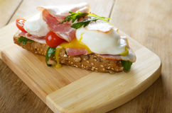 Bacon and poached eggs sandwich Stock Image
