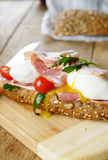 Bacon and poached eggs sandwich Royalty Free Stock Images