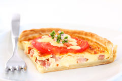Bacon quiche. Tradition French bacon quiche with onion, tomato and cheese royalty free stock photo