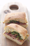 Bacon roll with cut side visible Stock Photo