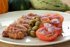 Bacon roll, organic tomato salad Stock Image