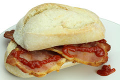 Bacon roll and tomato ketchup. Royalty Free Stock Photography