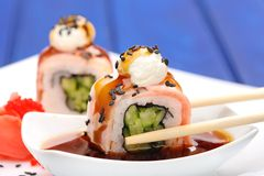 Bacon rolls with cucumber and sesame seeds deeped in soy sauce w Stock Images