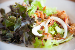 Bacon salad with deep fried chicken Royalty Free Stock Images