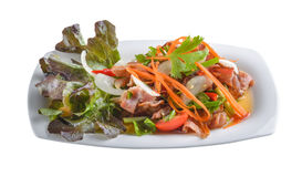 Bacon salad in white plate i Royalty Free Stock Image